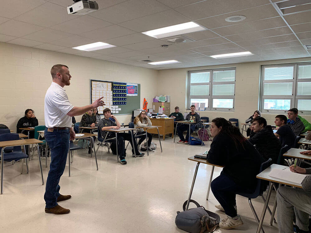 Chamber Member James Killen with Magnus Rewards talks to students at Bullitt Central High School