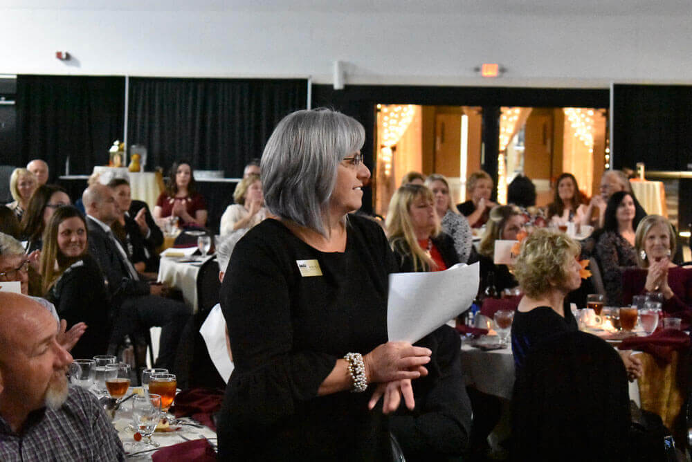 Bullitt County Chamber of Commerce Executive Director Anita Stump prepares to speak at the 2018 Annual Dinner