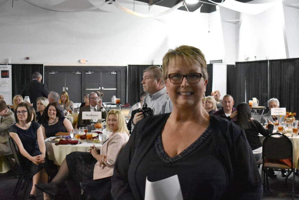 Bullitt County Chamber of Commerce Board President, Sherry Gentry, prepares to speak at the 2018 Annual Awards Dinner