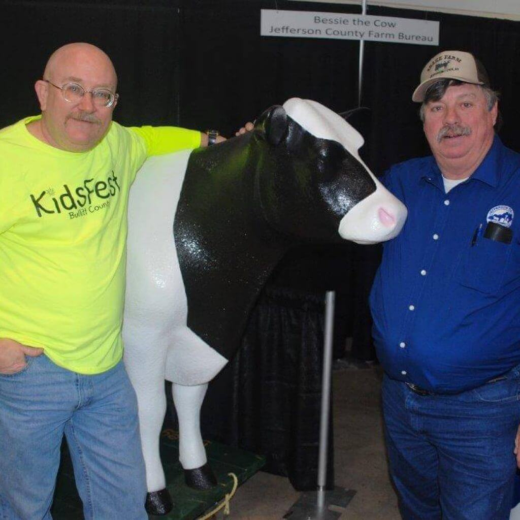 "2019 KidsFest - Jefferson County Farm Bureau poses with Bessie the Cow, an interactive fiberglass cow that children can ""milk"""