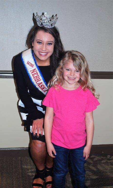 2019 KidsFest - Miss Nebraska poses with young child