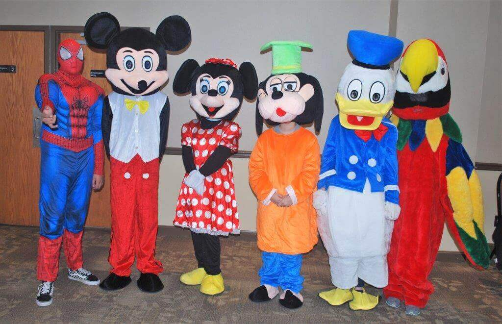2019 KidsFest - A variety of children's mascots: Spiderman, Mickey Mouse, Minnie Mouse, Goofy, Donald Duck, and a colorful parrot