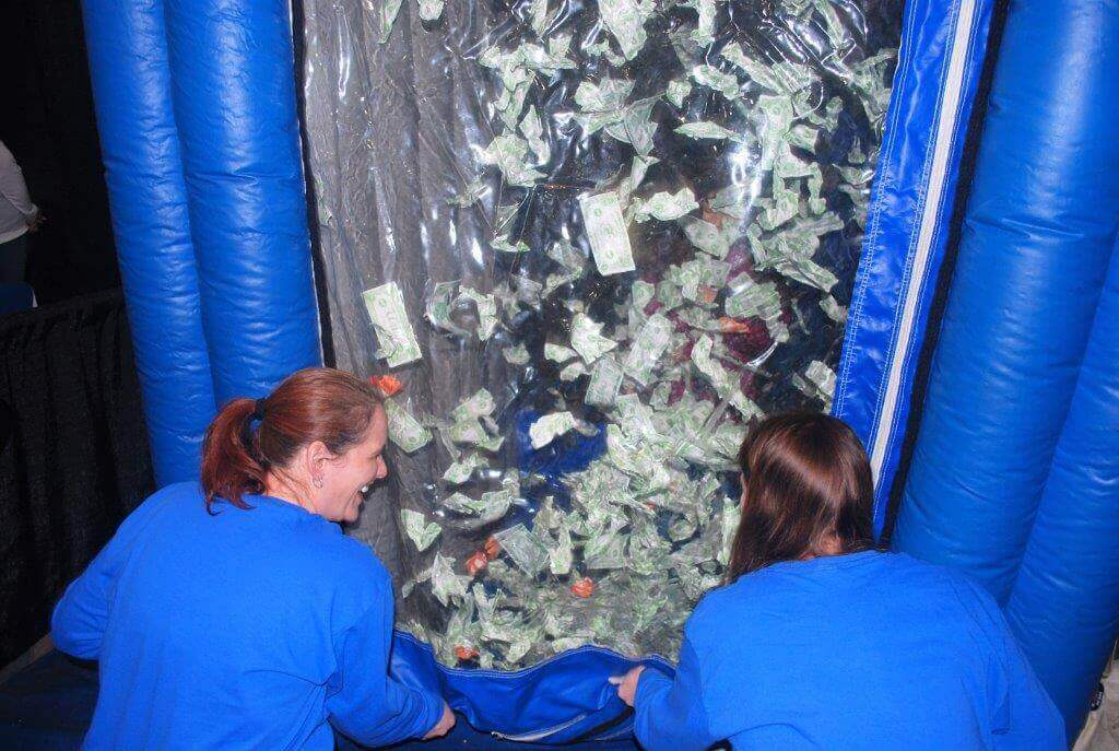 2019 KidsFest - A child is surrounded by pretend money in the PNC Bank Cash Cube