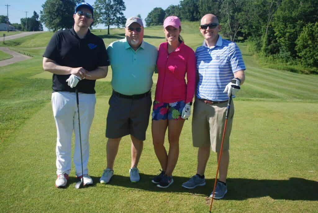 Winning team of the 2019 Bullitt County Chamber of Commerce Golf Outing posing on the green