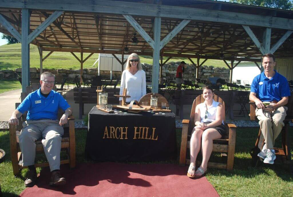 Board members John Straub, Grace White and Justin Guest pose with Cheri Martin of Arch Hill Bourbon Barrel Furniture