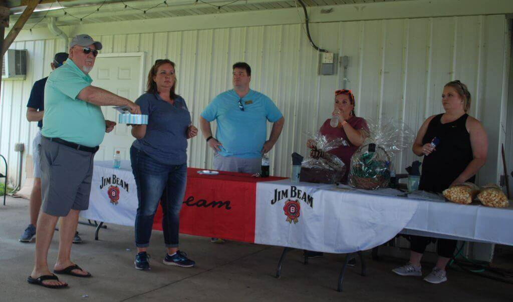 A group of people assists with handing out door prizes
