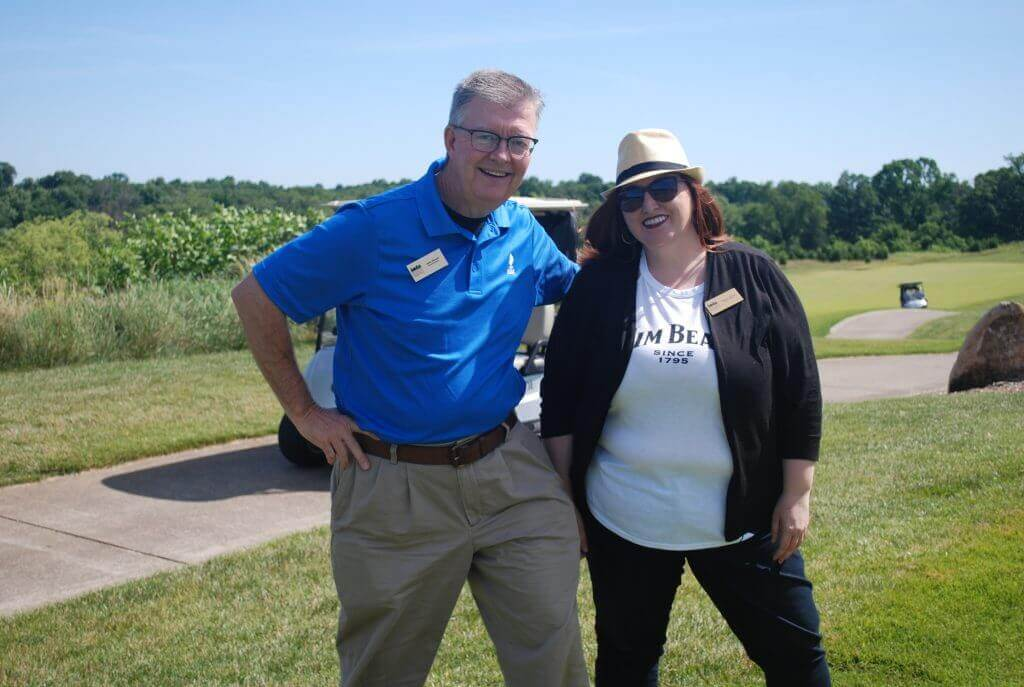Board Members John Straub and Raelyn Adkins smile for the camera