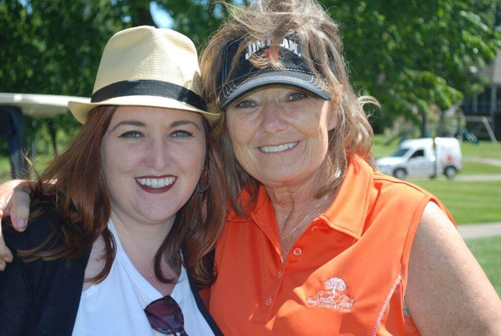 Board member Raelyn Adkins and her mom smile for the camera