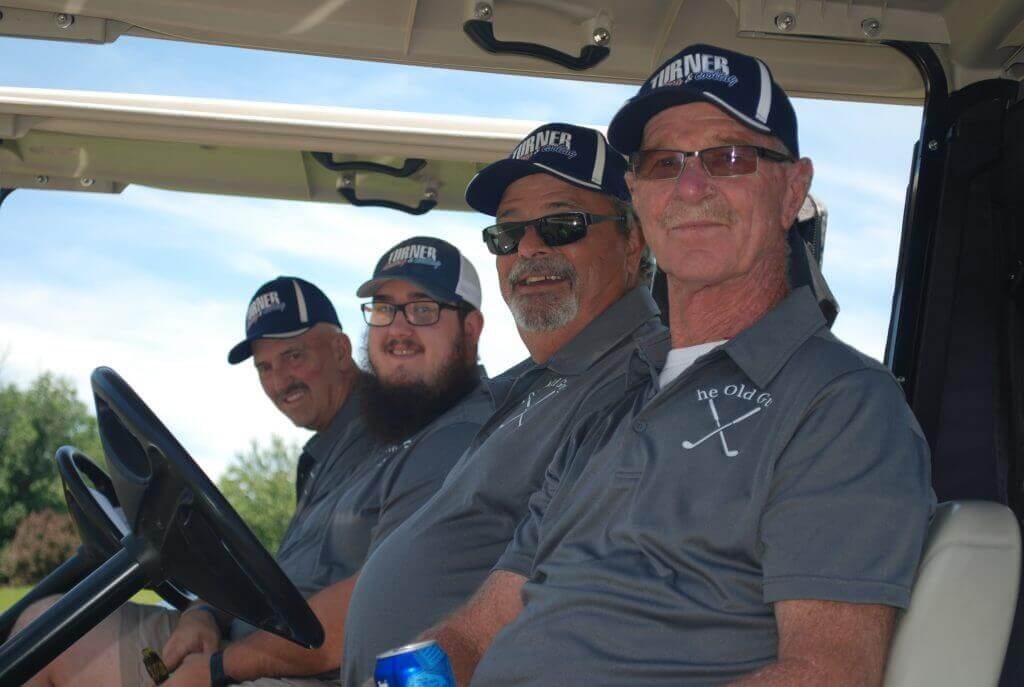 Turner Heating and Air team smile from inside their golf carts