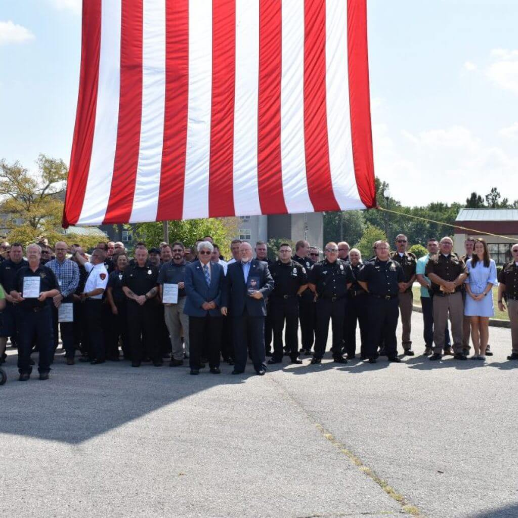 First Responders, County and State Officials under the beautiful American flag.