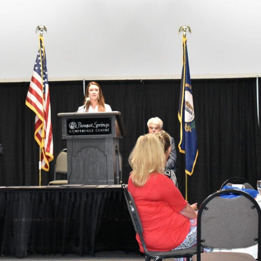 Kylie Fouschee Hubbard, Field Representative for Congressman Brett Guthrie speaking the the group.