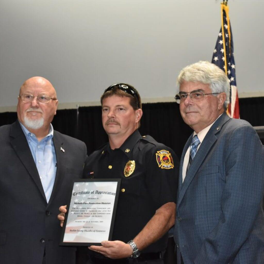 Plaque given to each department by the Bullitt County Chamber of Commerce. Award accept by a personnel from department and featuring Bill Laird and Judge Executive Jerry Summers.